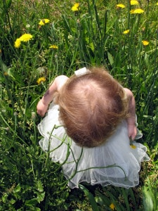 child in field flowers