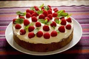 raspberries-on-cake-image