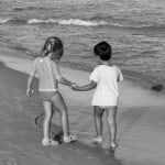 boy-and-girl-holding-hands-water-image