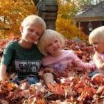 kids-playing-leaves-image