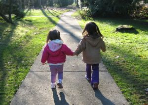 sisters-walking-sidewalk-image