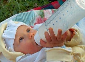 newborn_drinking_milk_outdoors_image