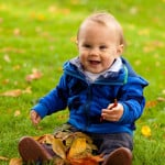 baby-with-fall-leaves-happy-image