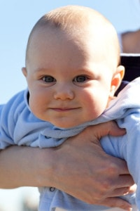 cute-smiling-baby-being-held-image