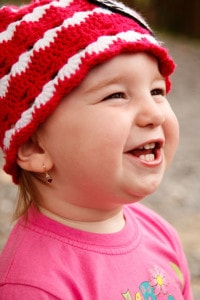 cute-baby-girl-red-white-hat-image