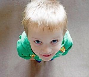 boy-green-shirt-looking-up-image
